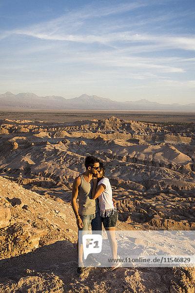 Chile  San Pedro de Atacama  couple standing on rock in the Atacama desert