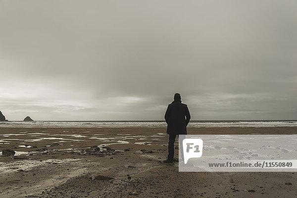 France  Bretagne  Finistere  Crozon peninsula  man standing on the beach