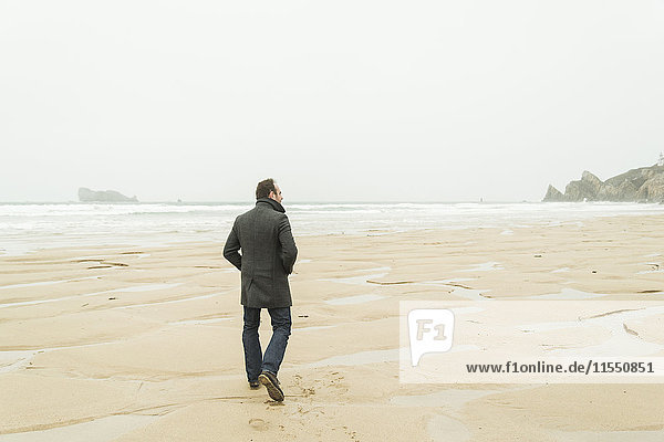 France  Bretagne  Finistere  Crozon peninsula  man walking on the beach