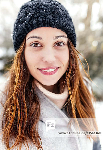 Portrait of a beautiful woman outdoors in winter