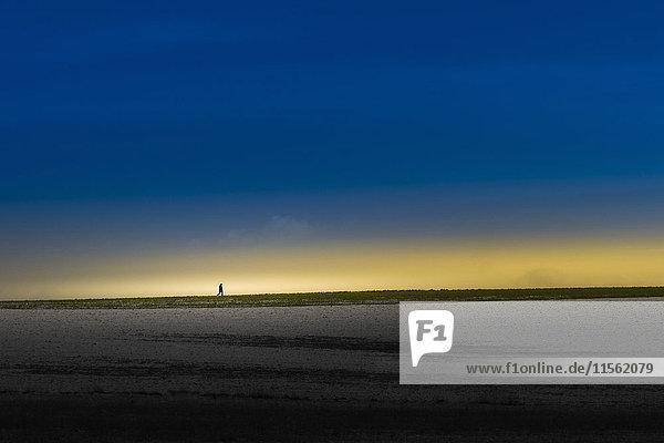 Silhouette des Menschen am Horizont