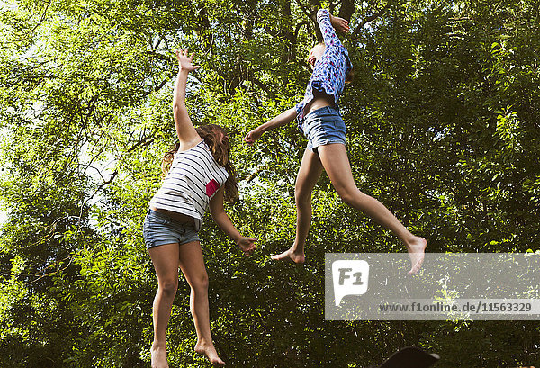 Sweden  Oland  Two girls (8-9  10-11) jumping