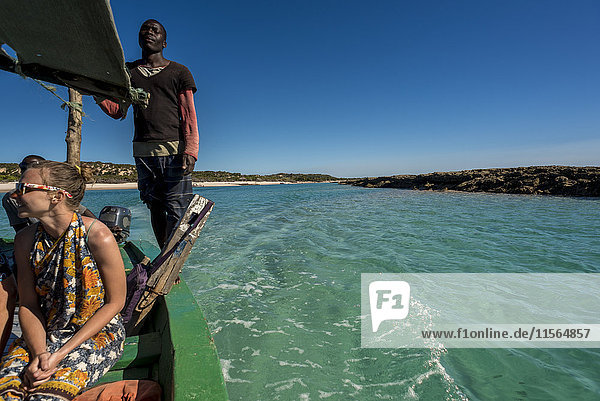 'Tourists in a Dhow on Benguerra Island  the second largest island in the Bazaruto Archipelago; Mozambique'