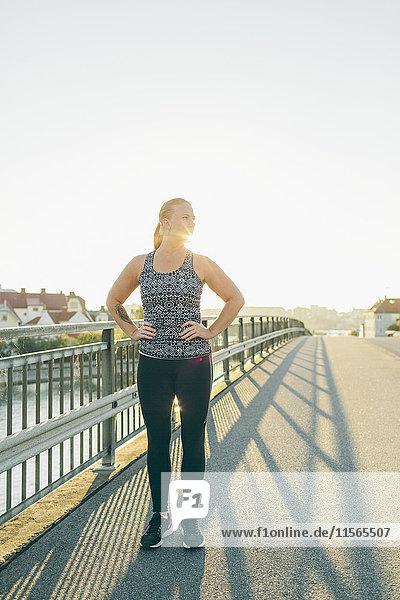 Sweden  Blekinge  Karlskrona  Young woman exercising on bridge