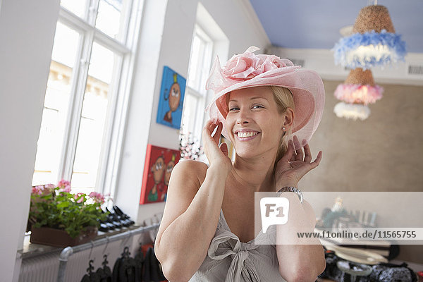 Woman in shop trying hat