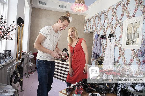 Happy couple in shop