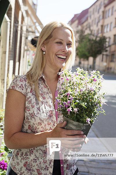 Happy woman holding flower bouquet