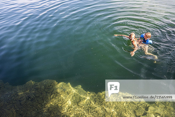 Mother swimming with child