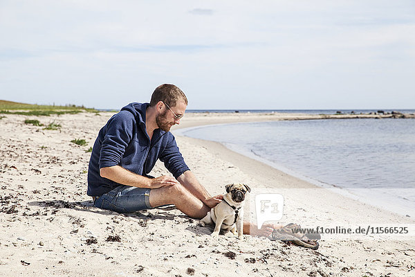 Man with dog on beach