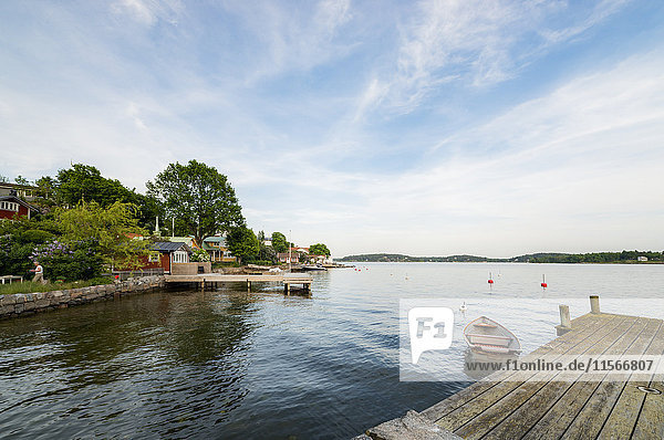 Sweden  Stockholm Archipelago  Uppland  Vaxholm  Rowboat moored to pier