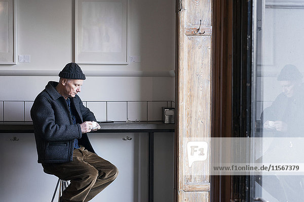 Senior man in cafe