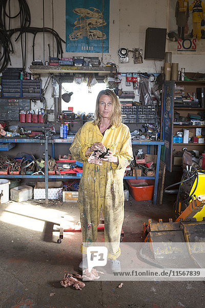 Woman mechanic in workshop