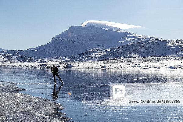 Man skiing on frozen lake