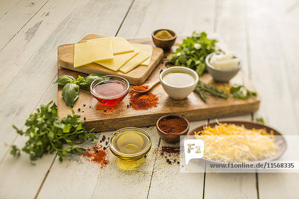 Cheese  oils and herbs on table