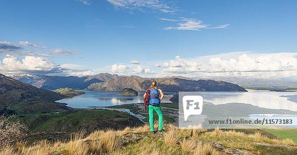 Hiker overlooking Lake Wanaka  Rocky Peak  Rocky Peak Park  Otago  Southland  New Zealand  Oceania