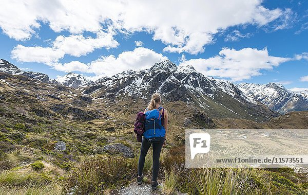 Hiker on the Routeburn Track  Westland District  Mount Xenicus behind  Mount Aspiring National Park  West Coast  Southland  New Zealand  Oceania
