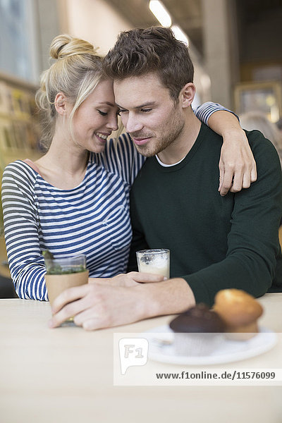 Romantic couple sitting together in cafe