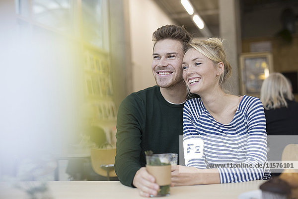Couple sitting with herbal tea in cafe