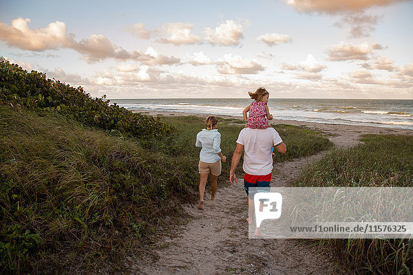 Family walking on coastal path,  Blowing Rocks Preserve,  Jupiter,  Florida,  USA