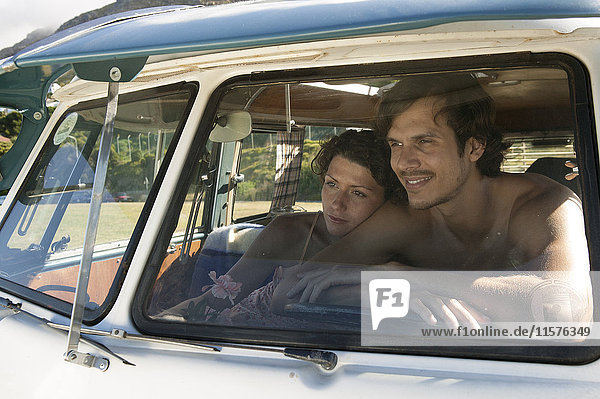 View through windscreen of couple in campervan