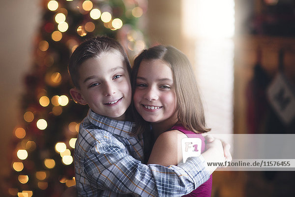 Portrait of brother and sister  hugging