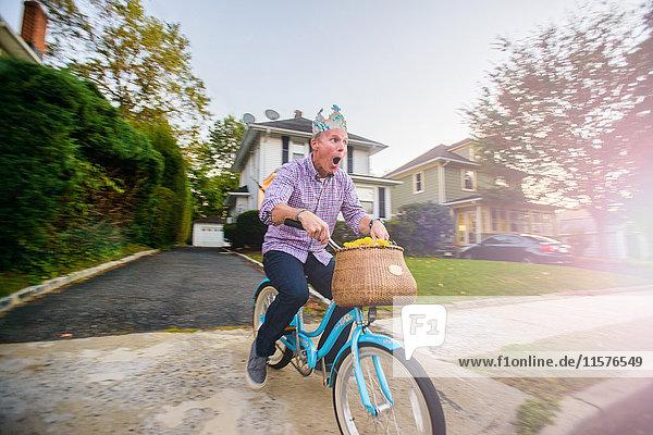 Man uncertain on vintage bicycle