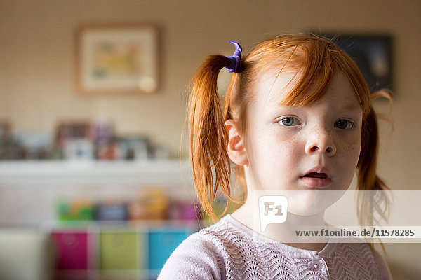 Portrait of young girl with red hair