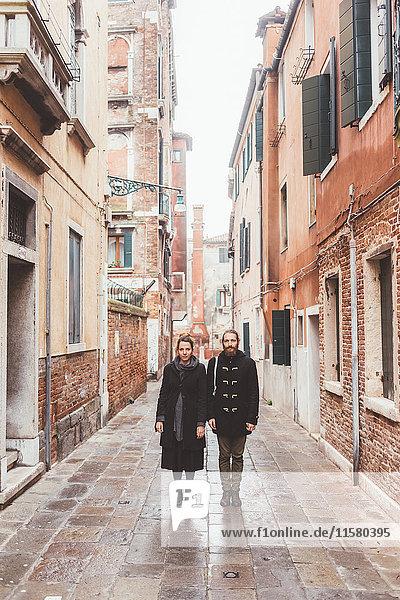 Portrait of couple in street  Venice  Italy