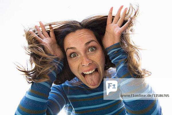 Woman making funny face at camera