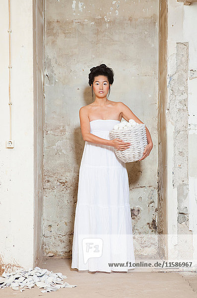 Woman carrying basket of dishes