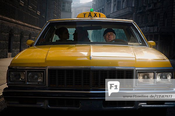 Taxi Driver Glancing at clients, Taxi Driver Glancing at clients