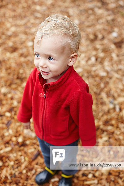 Toddler boy smiling outdoors