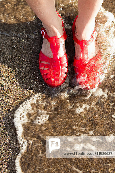 Woman wearing sandals on beach