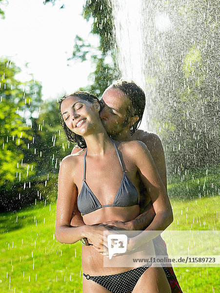 Couple under a water-jet