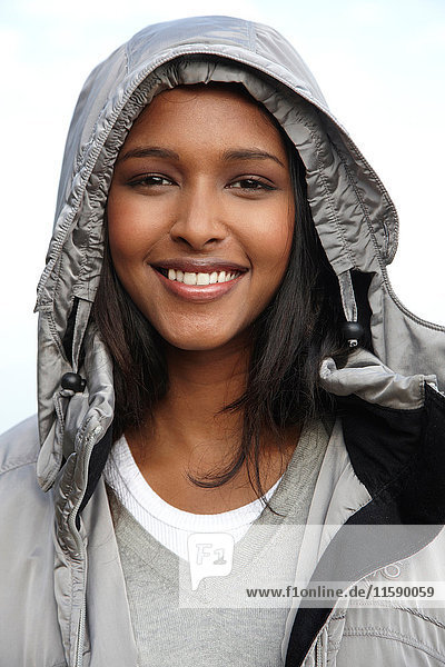Woman smiling wearing warm hooded jacket