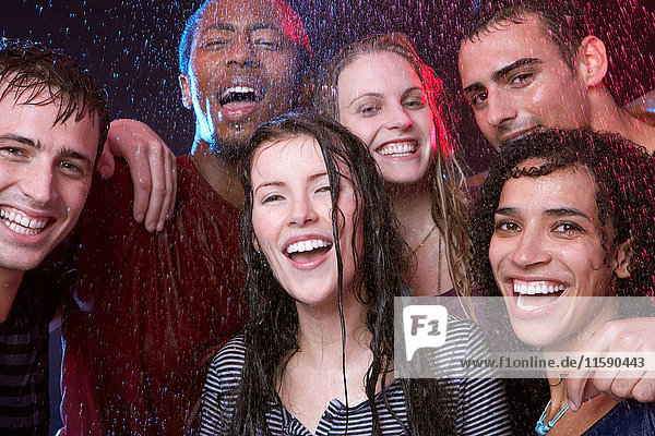 Group of young friends in the rain