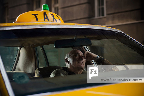 Taxi driver Waiting for fare in a taxi