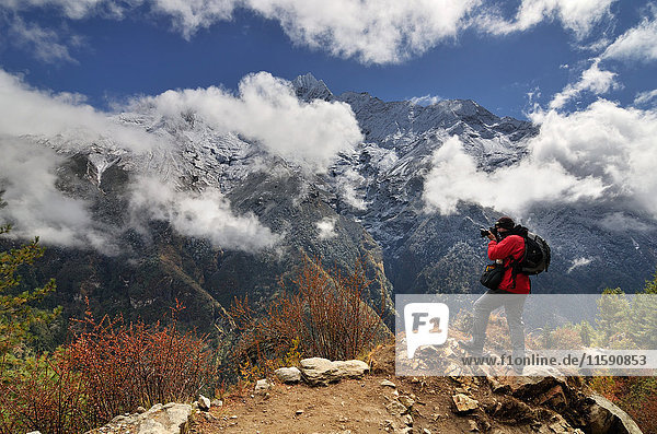 Photographer in the Himalayas on way from Namche Bazaar to Tengboche  Nepal