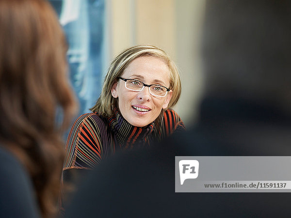 Mature woman in a meeting