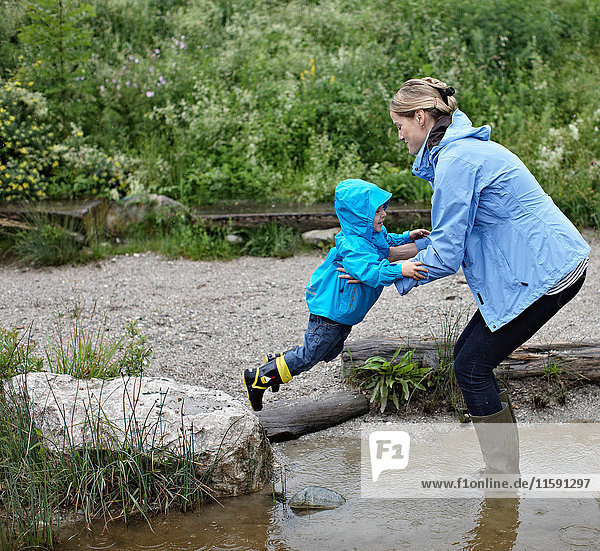 Mother and son playing in creek