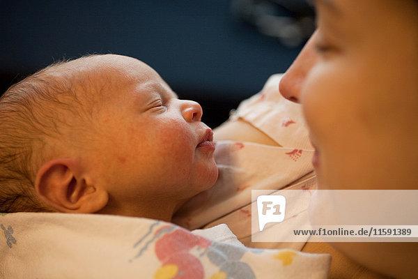 Mother holding newborn baby boy