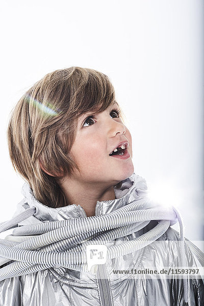 Amazed boy wearing fancy dress with tube wrapped around his neck