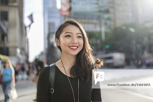 USA  New York City  Manhattan  portrait of smiling young woman