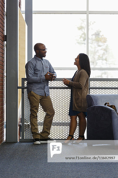 Man and woman talking in lobby