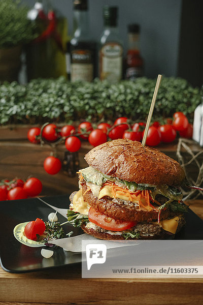 Gourmet cheeseburger on plate