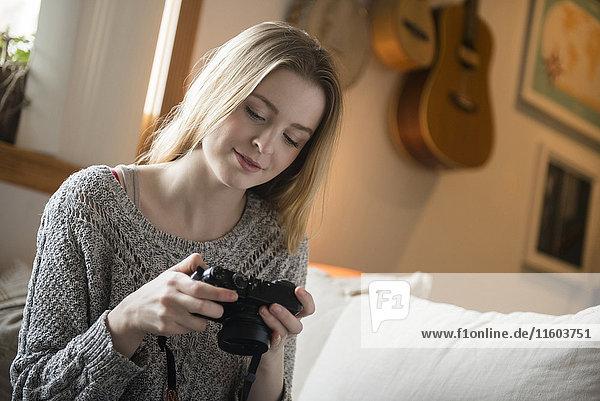 Woman examining camera