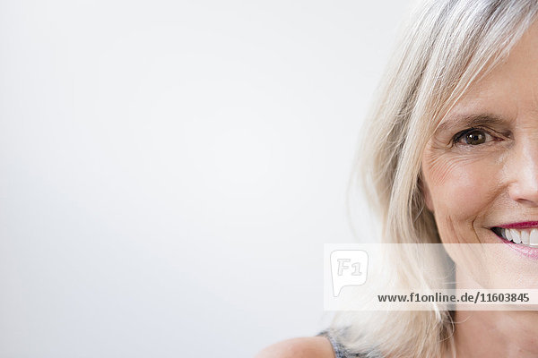 Portrait of half of face of smiling Caucasian woman