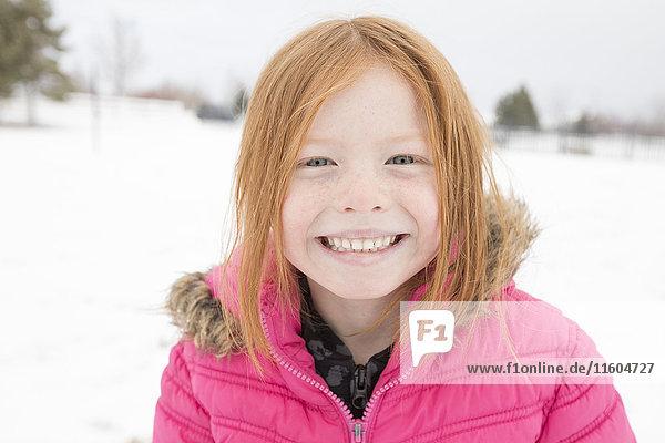 Portrait of smiling girl in winter