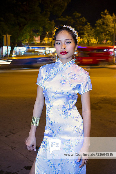 Portrait of serious Asian woman wearing traditional clothing