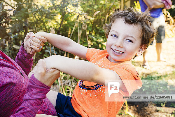 Portrait of Caucasian boy playing with mother